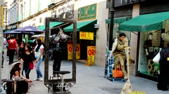 Mexico City, people walking and living statue artist. Stock Footage