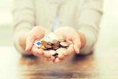 close up of senior woman hands holding money - stock photo