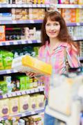 Beautiful woman posing with item - stock photo