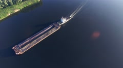 A tugboat and barge floating in the river. Aerial view. Stock Footage