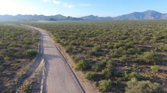 Aerial of semi truck traffic on a dirt road Stock Footage