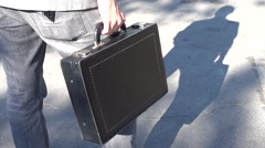 Man with briefcase and his shadow Stock Footage