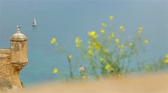 A sailboat on the horizon in sea - stock footage