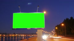 A Billboard with a Green Screen on a Busy Night Street.Time Lapse. - stock footage