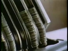 Closeup of person stacking coins in metal coin holder, 1970s - stock footage
