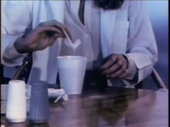 Medium shot of female adding sugar into beverage in disposable coffee cup, 1970s Stock Footage