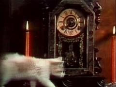 Kitten walking across mantel in front of clock, 1970s - stock footage