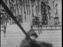 15th century reenactment of man climbing down building on rope, 1920s Stock Footage
