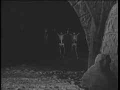 People in skeleton costumes emerging from cave, 1920s Stock Footage