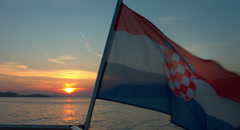 Sunset off the Coastline of Dubrovnik with Croatian Flag Graded - stock footage