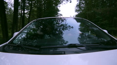 Reflection in Windscreen. Car drives through forest. On-board-camera Stock Footage