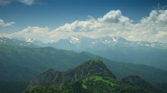 Mountain under the blue sky with clouds Stock Footage