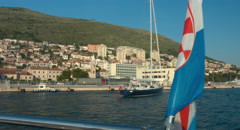 Boat Cruise Bay of Dubrovnik with Croatian Flag during Sunset Golden Hour Graded Stock Footage