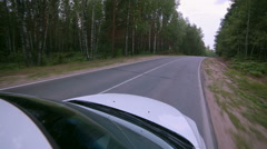 On board camera. Car driving through forest road Stock Footage