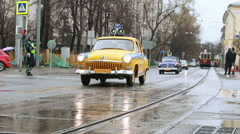 Old police cars driving on the street. Stock Footage