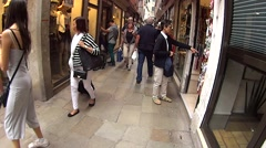 The camera moves around the street in Venice. Stock Footage