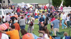 Large crowd of families at a Hot Air Balloon Festival Stock Footage