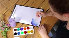 Artist Paints a Picture Stock Footage