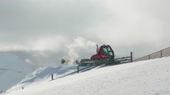 Snowplow by a Wyoming mountain Stock Footage
