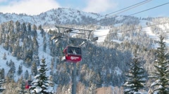 Close up of Jackson Hole ski lift with snow and mountains 3 Stock Footage