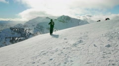 Person skis down a mountain with beautiful mountain scenery Stock Footage