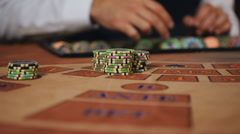Luck smiled player. The dealer moves the player's winnings Stock Footage