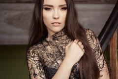 Beauty fashion woman portrait wearing black top with perfect smokey makeup Stock Photos