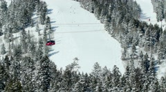 Ski lift elevates over snow covered mountainside 6 Stock Footage