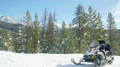 Close up of snowmobiles driving through woods 2 Stock Footage