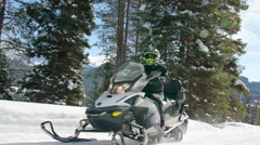 Close up of snowmobiles driving through woods Stock Footage