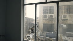 Window view at collapsed, ruined buildings in ghetto city block Stock Footage