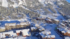 Drone video of winter village and mountains 2 Stock Footage