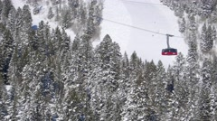 Ski lift elevates over snow covered mountainside 3 Stock Footage