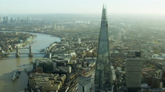 Aerial view of the River Thames and Shard Skyscraper London UK - stock footage
