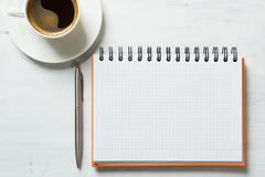 Coffee with notepad and pen Stock Photos