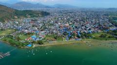 Flight over Pokhara Nepal 4k aerial video. Flying view Phewa lake mountains city Stock Footage