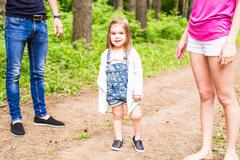 Cute little baby girl on walk with parent Stock Photos