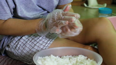 Close-up hand of woman shaping sticky rice for making sushi Stock Footage
