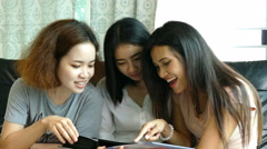Three girls looking photo album - stock footage