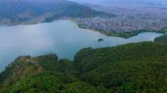Flight over Pokhara Valley city Nepal aerial 4k video. Phewa lake mountain Stock Footage