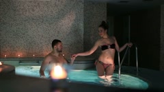 Couple relaxing and speaking together in a sauna at the hotel spa Stock Footage