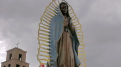 Low Angle of a Statue of the Virgin Guadalupe by a Mexican Catholic Church - stock footage