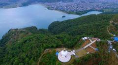 Aerial Flight 4k video over buddhist stupa Pokhara Valley Phewa lake Nepal Stock Footage