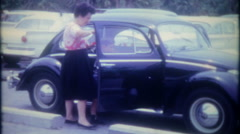 Mom and children get into their new Volkswagen Bug, 3425 vintage film home movie Stock Footage