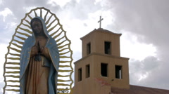 Tilt to Reveal a Statue of the Virgin Guadalupe and a Mexican Catholic Church Stock Footage