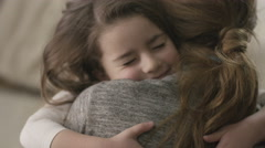 4K Daughter rushes into mother's arms at home and gives her a big hug. Stock Footage