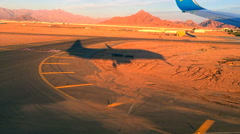 Aircraft landing in Egypt at red sunrise sunset. HD travel video from airplane Stock Footage