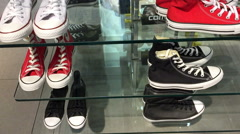 Indoor sport shoe shop HD travel video. View of Converse shoe shelves. Stock Footage