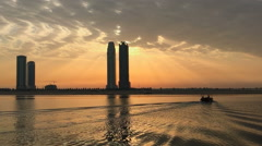 Sharjah cityscape UAE Time-lapse HD video. Sunset city skyscraper from water Stock Footage