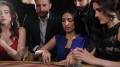 Beautiful girl in blue dress enjoys the winnings in blackjack Stock Footage